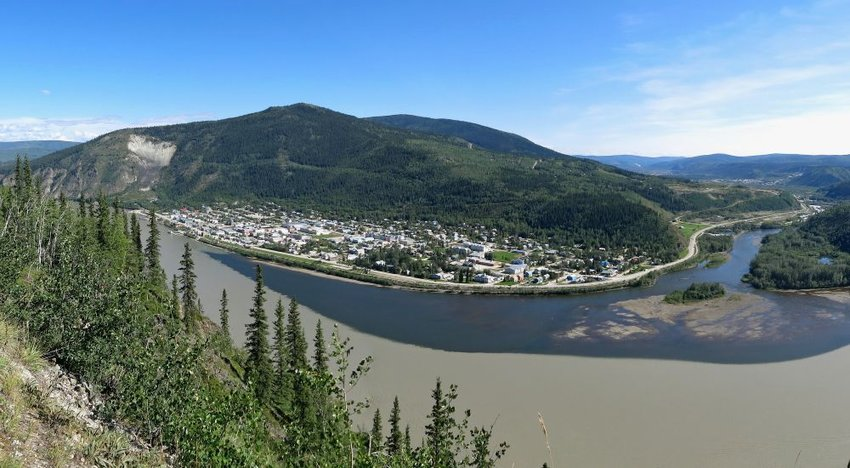 Aerial view of river and hills in Dawson City, Canada