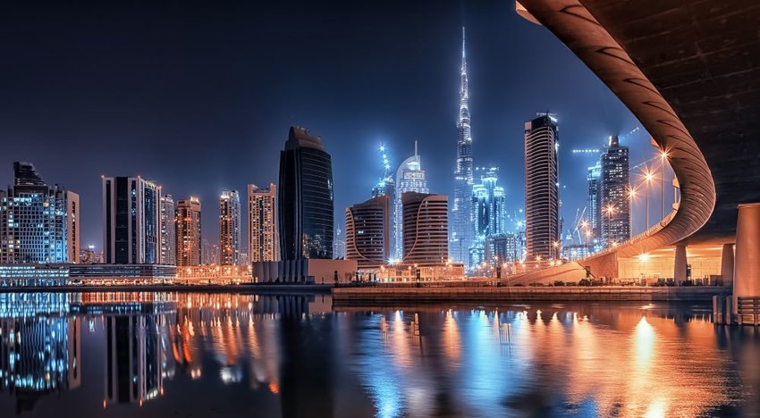 Photo of the skyline of Dubai illuminated at nighttime