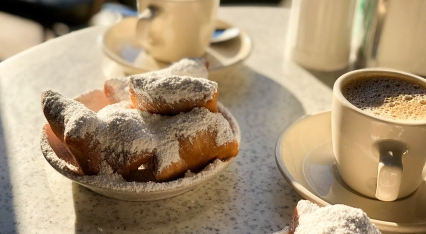 Close up photo of beignets and coffee