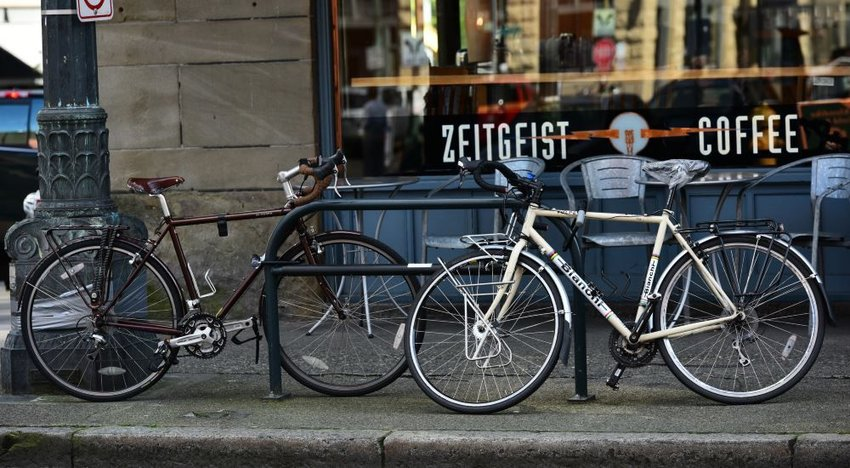 Photo of two bicycles in front of a coffee shop