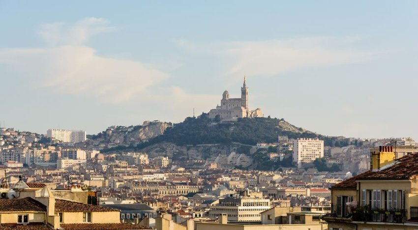 Photo of a large, old basilica on a hill above Marseille, France