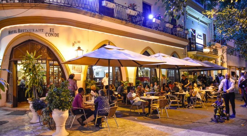 Photo of people sitting at tables on a patio