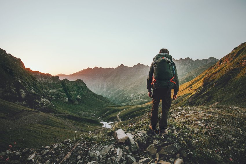 Person backpacking through mountains