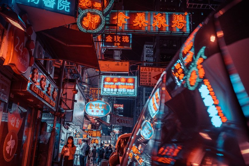 Photo of a street at night in Hong Kong