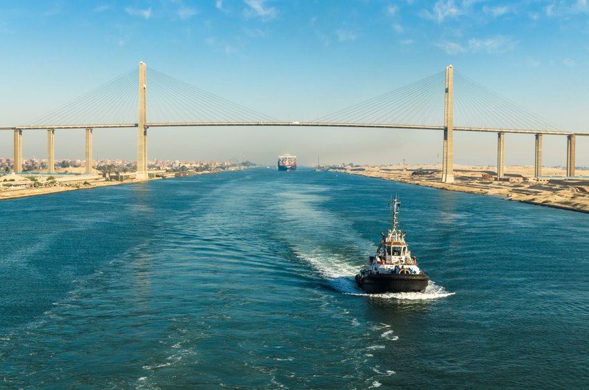 Boats passing under a bridge in Suez