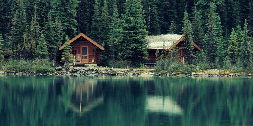 Small wooden cottages on a lake