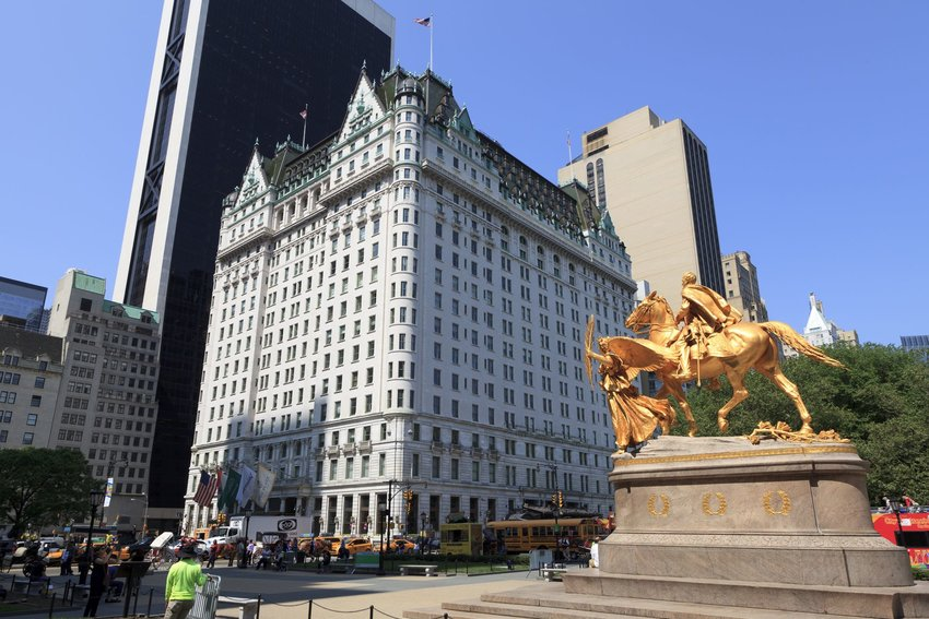 The Plaza Hotel with a statue in the foreground