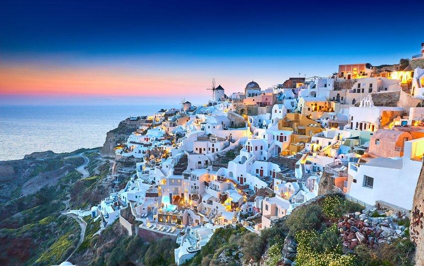 Cliffside village of white buildings overlooking the ocean