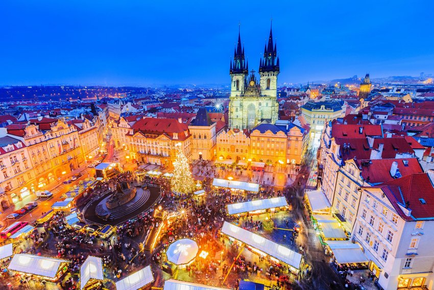 Aerial view Prague's city square with Christmas trees and holiday lights