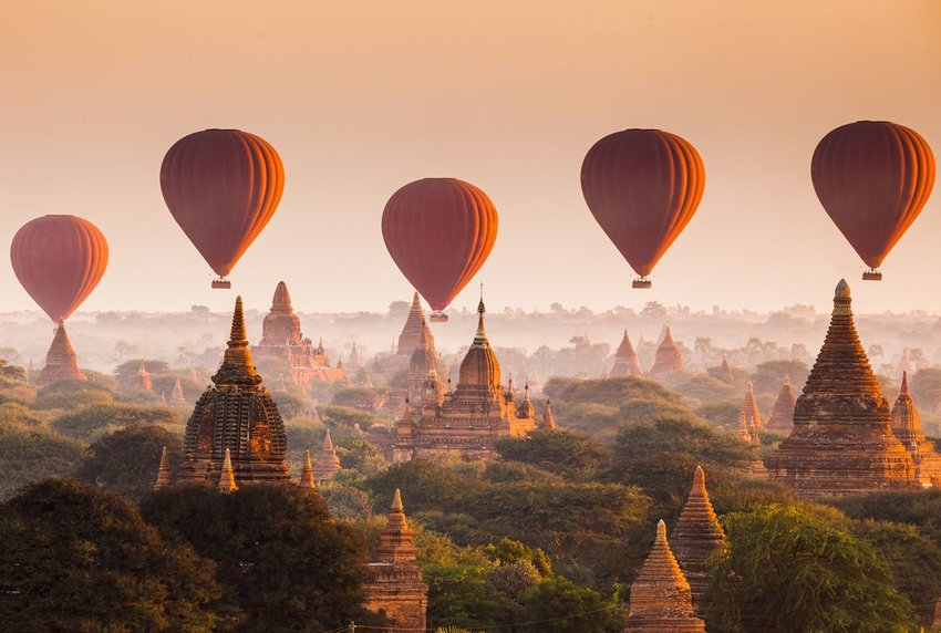 Hot air balloons over the Bagan, Myanmar, cityscape
