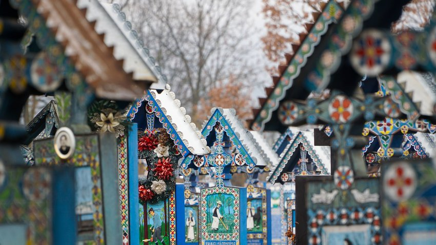 Close-up of the blue, brightly painted crosses at the Merry Cemetery