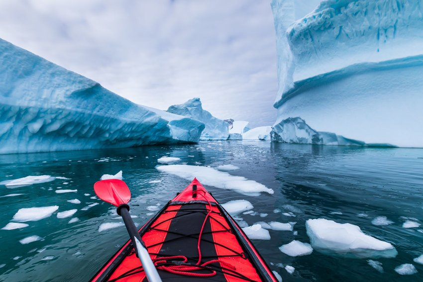 Photo taken from a red kayak of Pléneau Island in Antarctica
