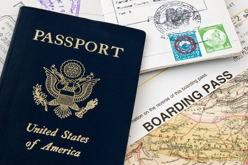 A United States passport and boarding pass
