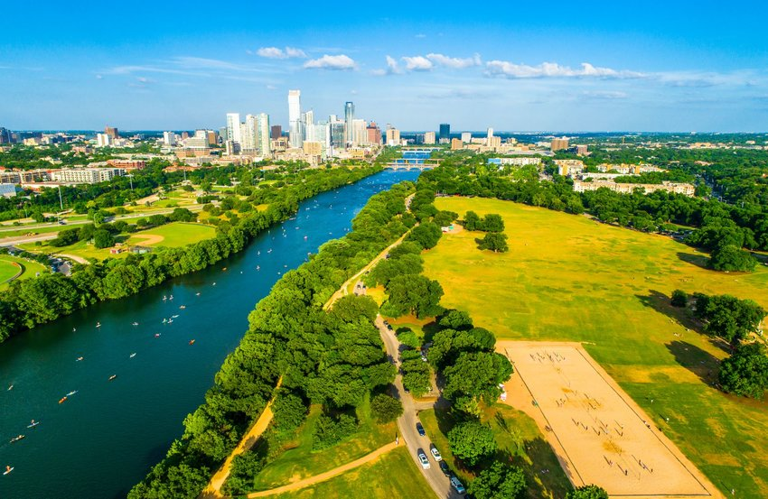 Aerial view of Zilker Park with Austin in the background