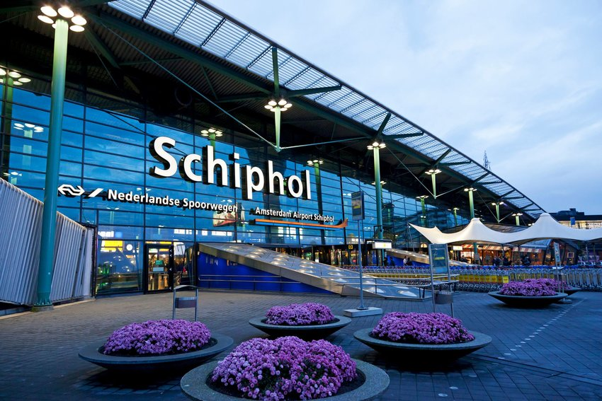 Schiphol Amsterdam airport exterior at dusk