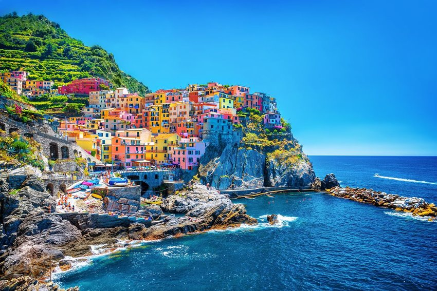 Colorful buildings on a cliff over the ocean in Cinque Terre, Italy