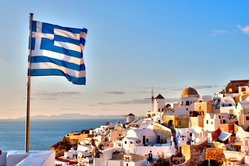 Greek flag overlooking Oia