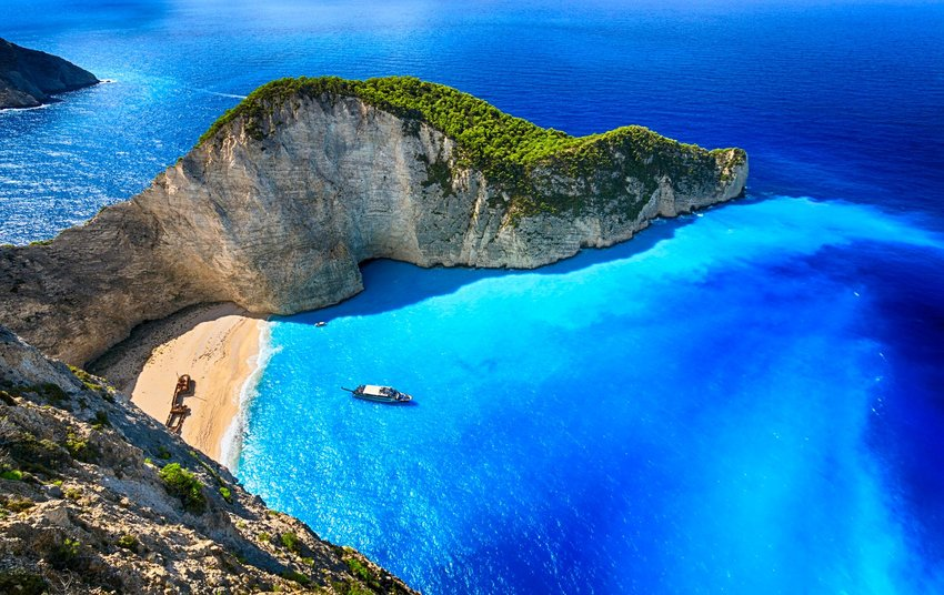 aerial shot of Greek island with beach