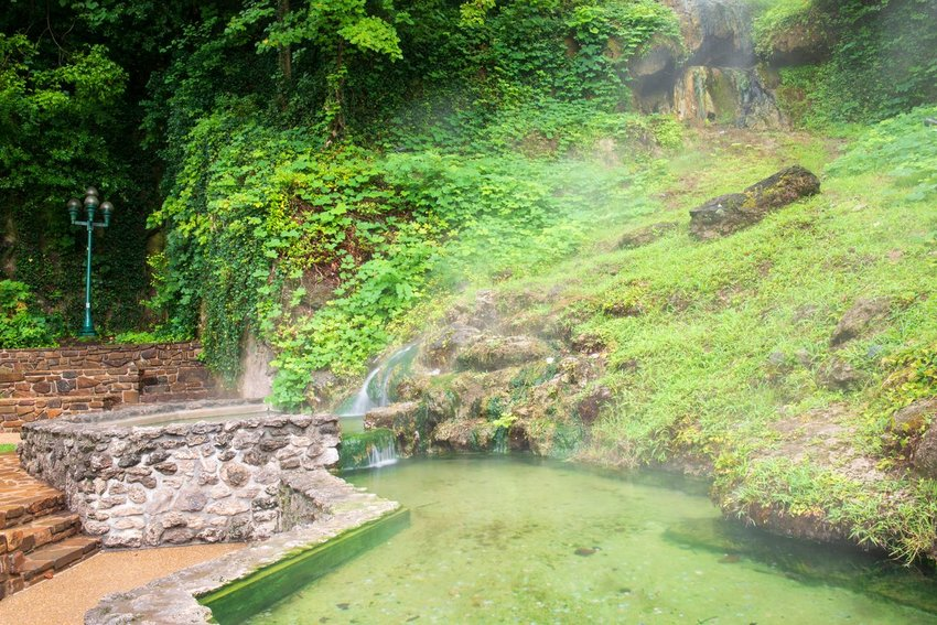 Hot springs sounded by greenery in Hot Springs National Park in Arkansas