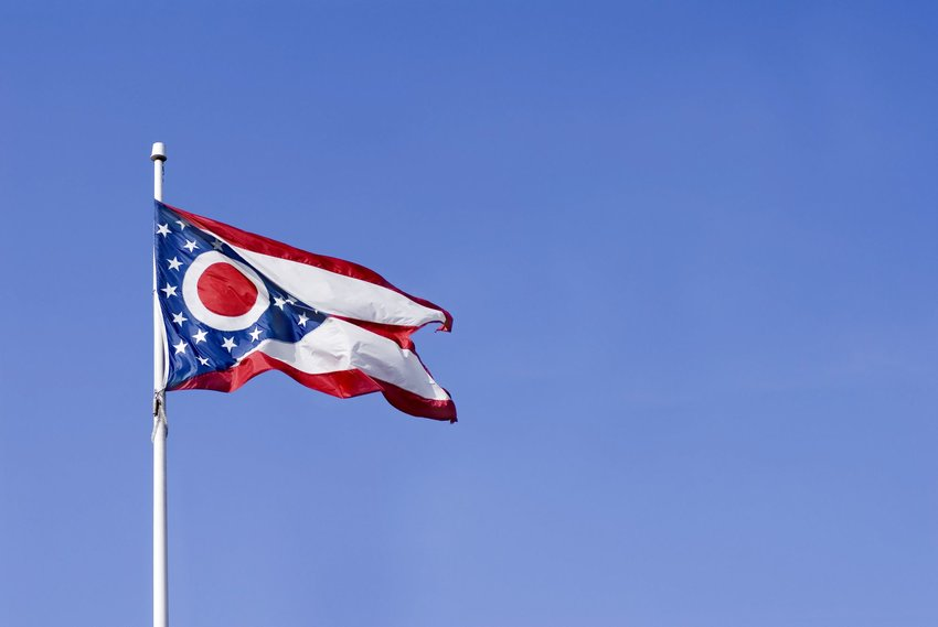 Ohio state flag against blue sky
