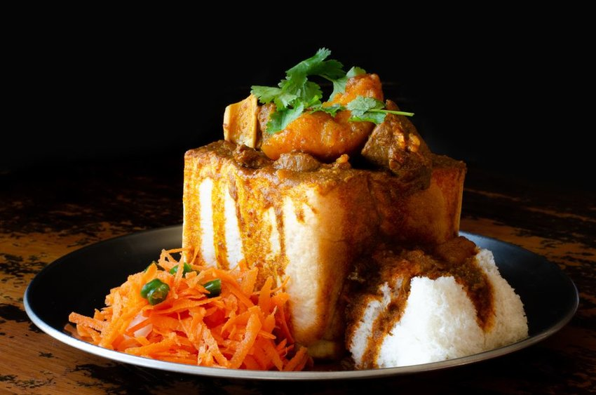 Durban bunny chow with mutton curry, rice, and carrot sambal