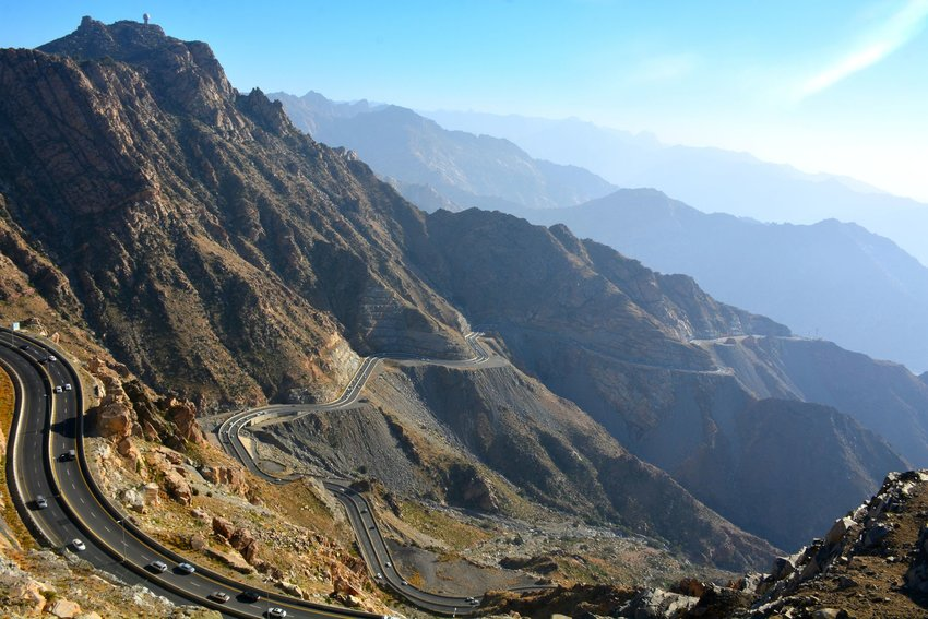 Aerial view of a road winding through the Hijaz Mountains