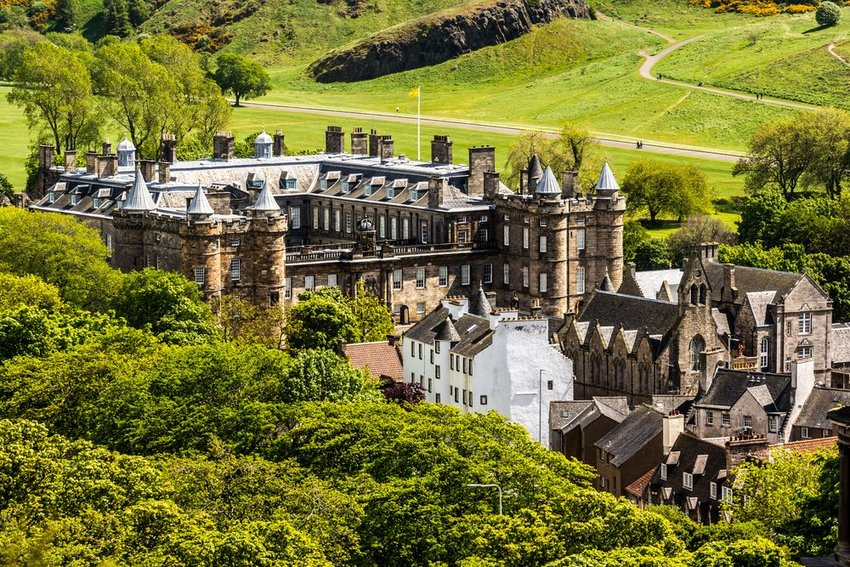 A side aerial view of the Palace of Holyroodhouse