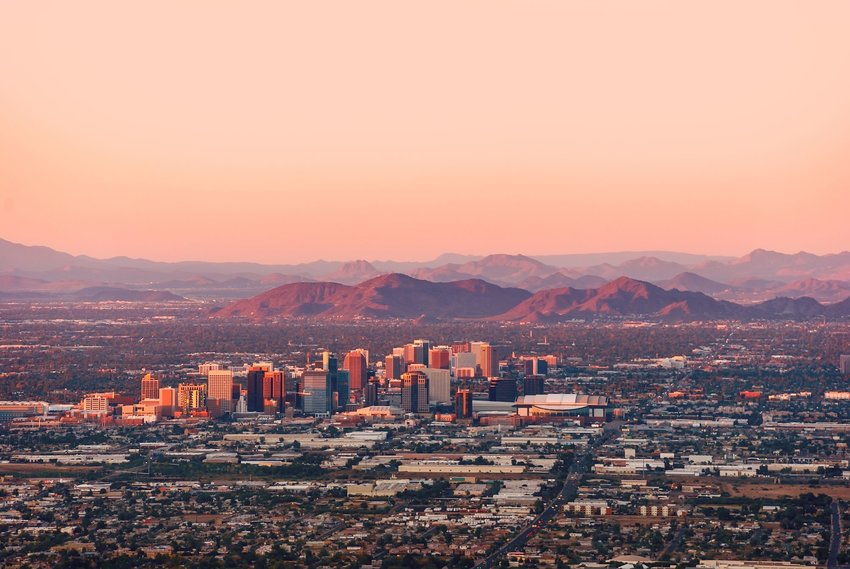 Phoenix, Arizona, with its downtown lit by the last rays of sun at the dusk