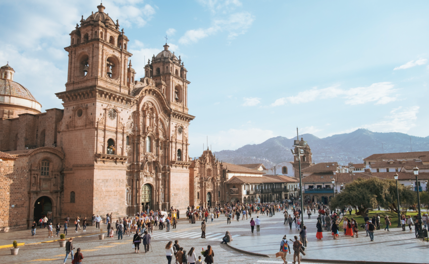 Plaza de Armas with the Church of the Society of Jesus in the background in Cusco, Peru