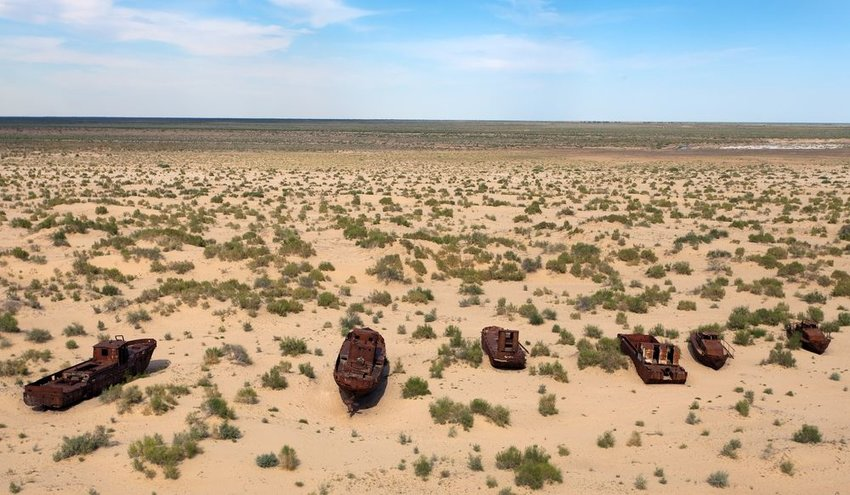 Rusted boats in the dried-up Aral Sea between Kazakhstan and Uzbekistan