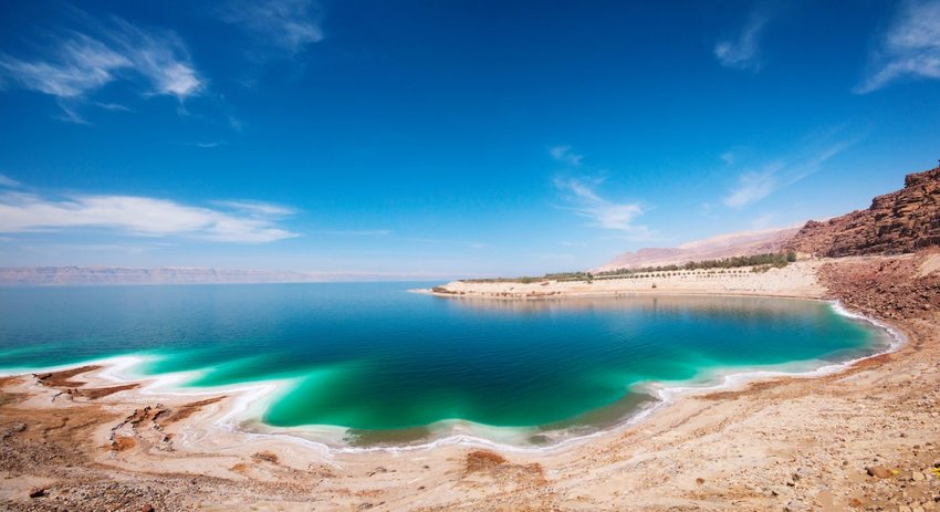 Shore of the Dead Sea in Israel with a wide blue sky