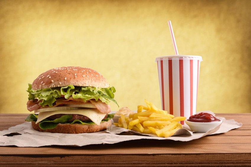 Burger, soda, fries, and ketchup