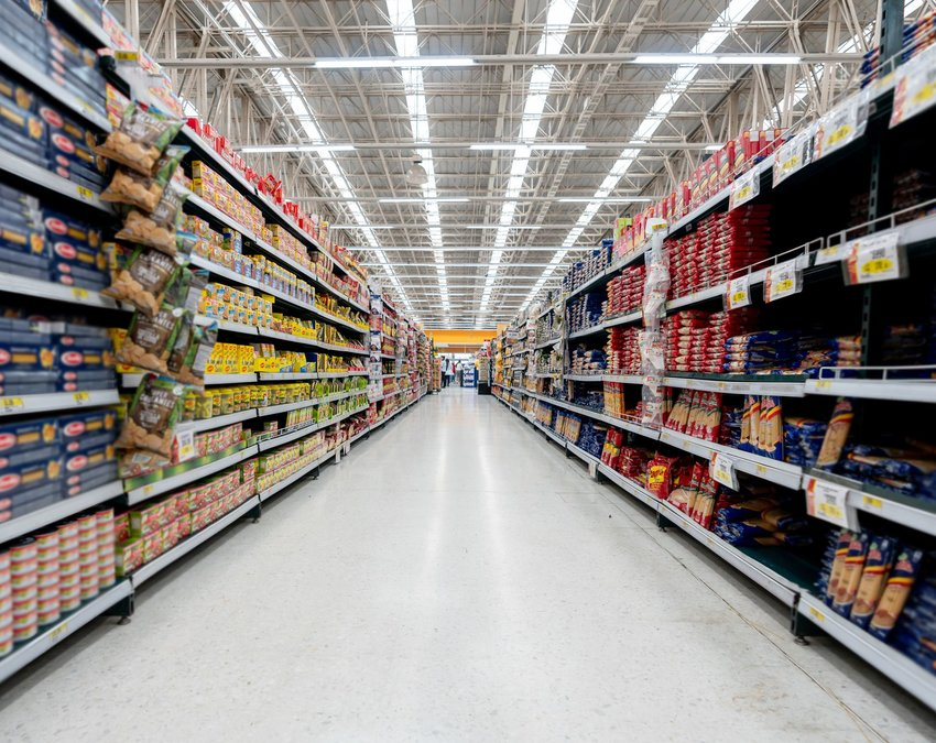 Supermarket aisle with tons of food on the shelves