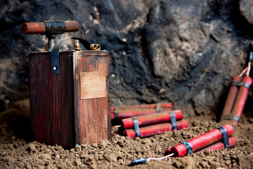 Red sticks of dynamite and an old-fashioned detonating fuse.