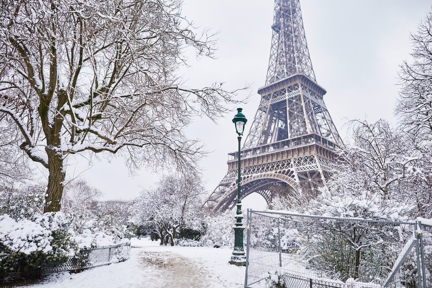 Eiffel tower on a day with heavy snow