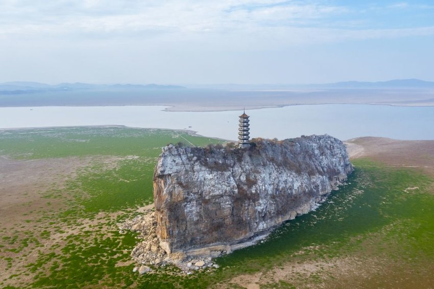 Hill with building during dry season in Poyang Lake, China