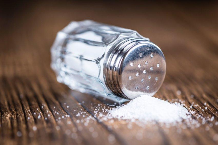 salt shaker spilling on table