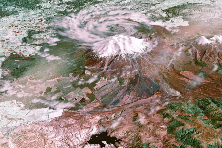 Satellite view of Snow-capped Ruapehu Volcano covered in swirling clouds