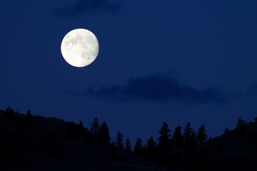 Full Moon rises over the Cascade Mountains, in north central Washington State