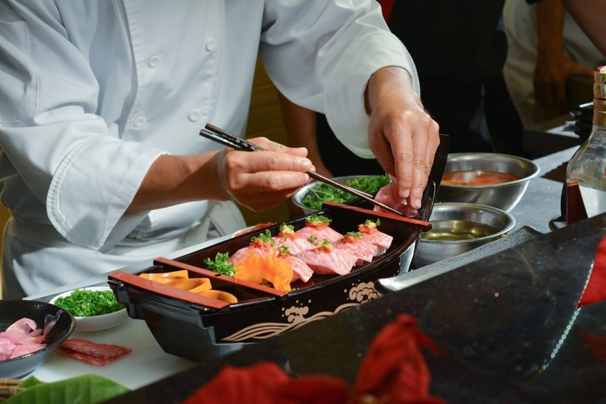Chef making sushi at Japanese restaurant