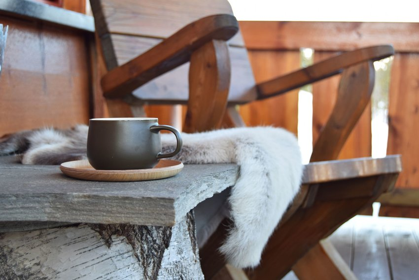 Cup of coffee on a Norwegian porch in the winter
