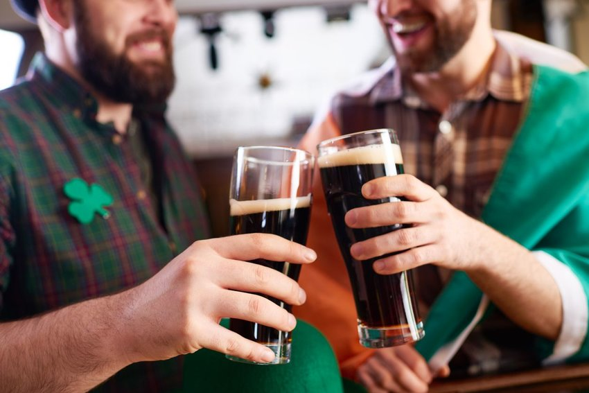 Irish men toasting each other in a pub on St. Patrick's Day