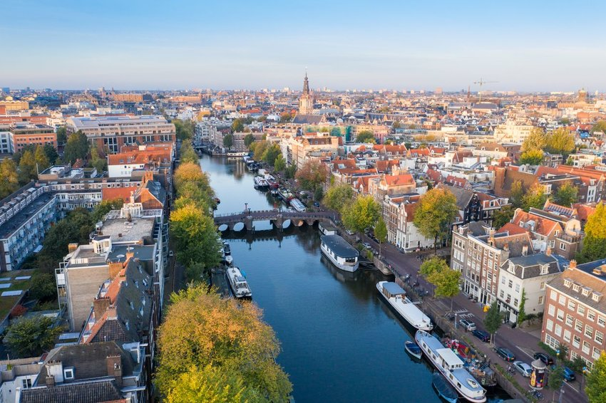 An aerial view of Amsterdam showing canals and bridges