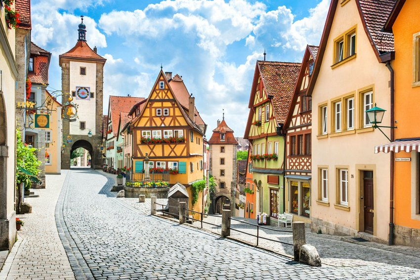 A street in Rothenburg ob der Tauber on a sunny day with blue sky and clouds in summer