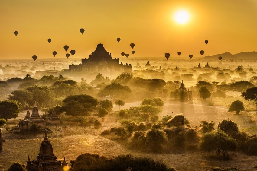 Scenic sunrise with hot air balloons above Bagan's temple landscape