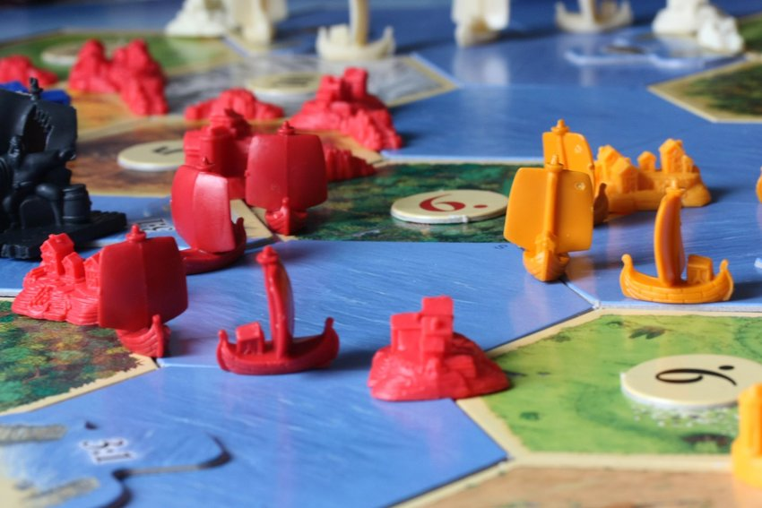Game pieces in a Settlers of Catan board game