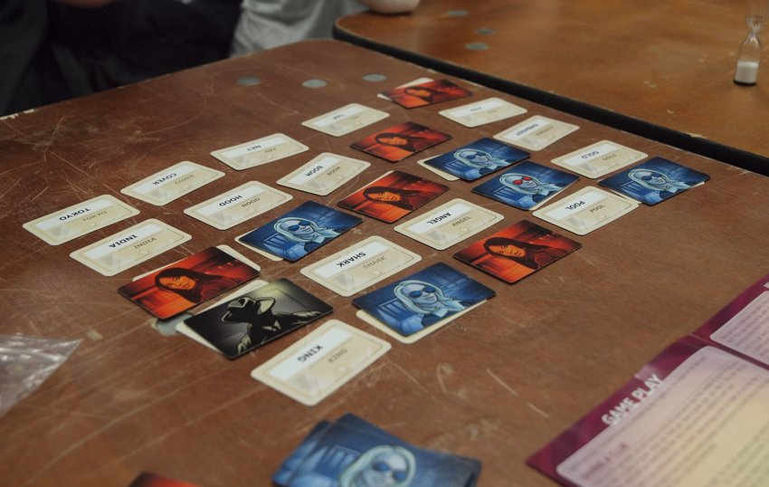 Cards from Codenames board game spread out on table