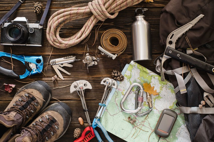 Hiking and mountaineering gear laid out on table