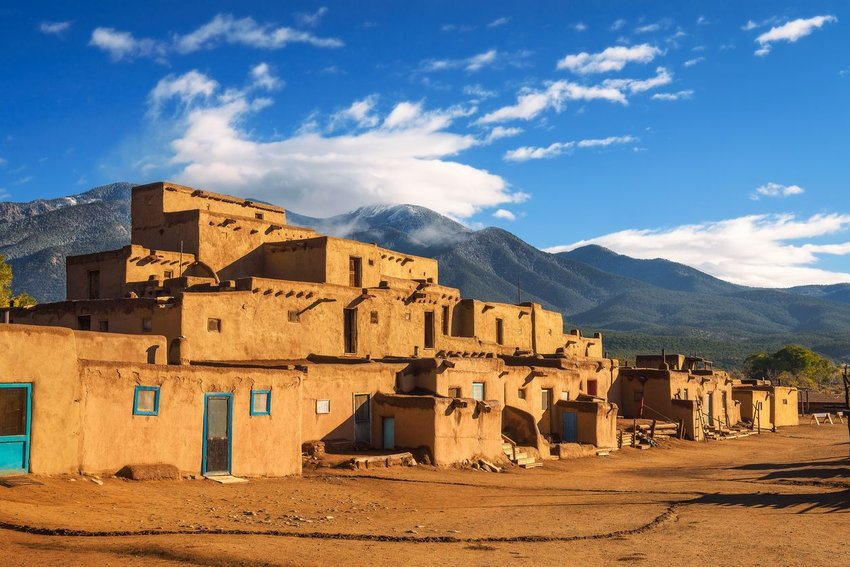 Beautiful adobe Pueblo of Taos in New Mexico beneath the mountains
