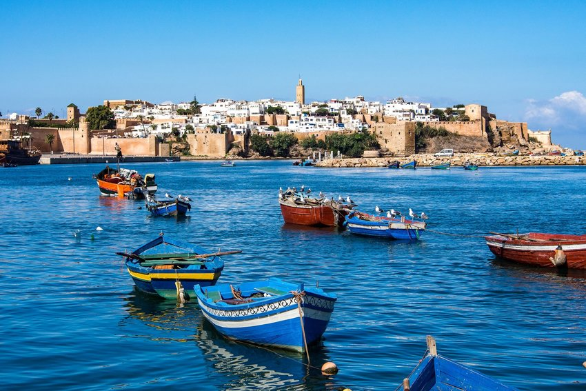 The city of Rabat as seen from the harbor with many colorful fishing boats